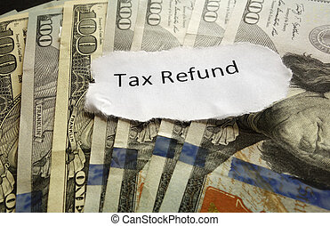 Tax Refund paper text on assorted cash...