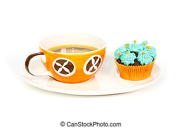 Cup of coffee and cupcake with blue cream frosting