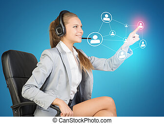 Businesswoman in headset using virtual interface