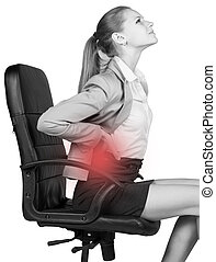 Businesswoman with lower back pain, sitting on office chair...