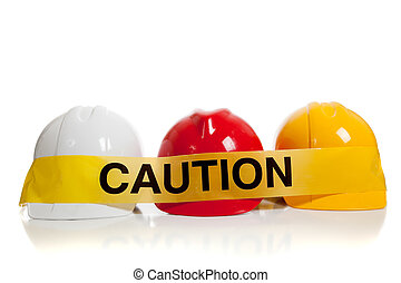 various hard hats with caution tape - various colored hard...