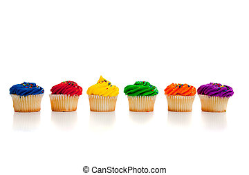 multi colored cupcakes - Multi colored cupcakes on white...