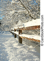 Rural winter landscape.  - Snow covered fence.