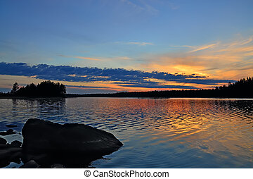 Karelian sunset. Lake Engozero, North Karelia, Russia -...