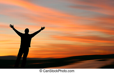 Faith 3 - Man with outstretched arms facing a beautiful...