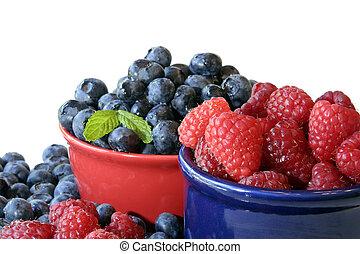 Summer berries, raspberries and blueberries, water droplets...