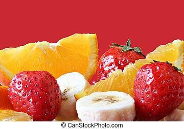Fruit close-up - Strawberry, orange and banana.