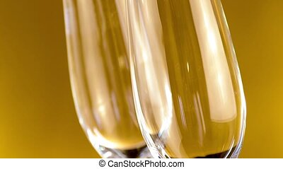 flutes of champagne on golden - a pair of flutes of...