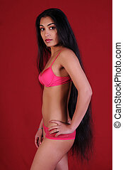 Indian woman - Beautiful long haired Indian woman in pink...