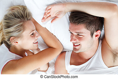 Couple relaxing in bed - Couple relaxing together in bed