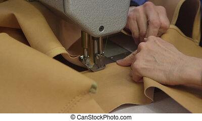 Seamstress sewing cushion for sofa - Professional seamstress...