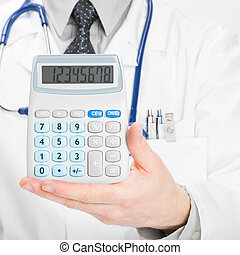 Doctor with calculator - heath care concept