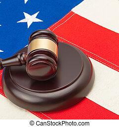 Judge gavel and soundboard over USA flag - closeup studio shot