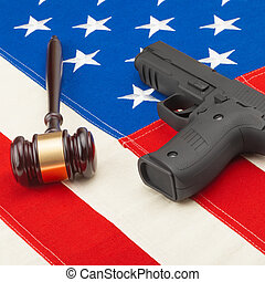 Judge gavel and hand gun over USA flag - studio shot