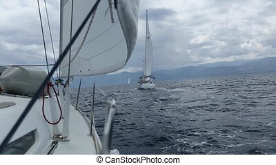 Boat in sailing regatta.
