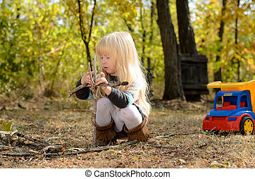 Little girl playing outdoors in the garden