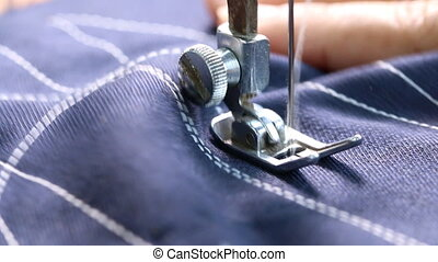 working with sewing machine - Woman working with sewing...