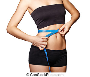 Girl measuring waist - Fit and healthy young lady measuring...