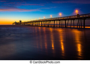 The fishing pier seen after sunset, in Imperial Beach,...