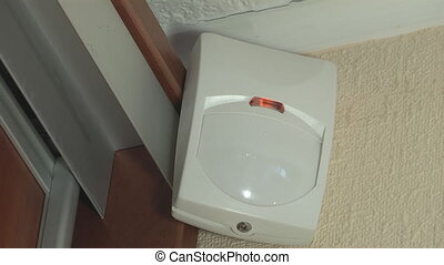 motion sensor - a simple white motion detector is installed...