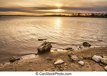 Rocky Shoreline Sunset - Smithville Lake towards dusk as the...