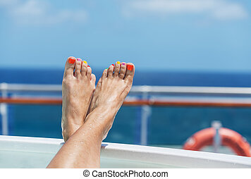 cruise vacation - female feet on board a cruise ship - the...