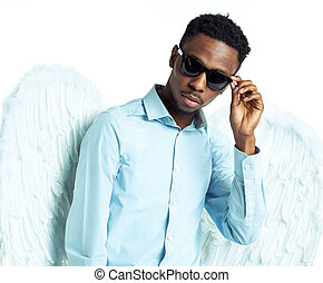 African American man with angel wings in sunglasses -...