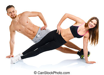 Sport attractive couple - man and woman doing fitness...