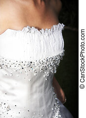 Wedding Gown - Close up of detail on wedding gown decorated...