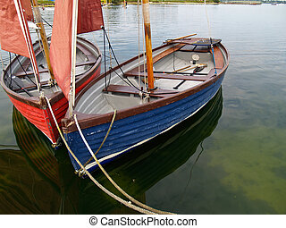 Sailing dinghies. - Sailing dinghies,tied to jetty.