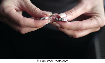 Hands of girl hold two rings close up