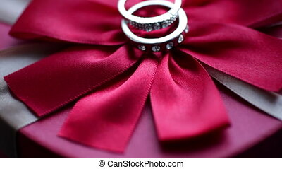 Wedding rings on a bow - Wedding rings on a red bow