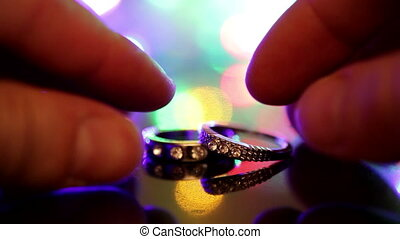 Wedding rings on a colorful flashing background