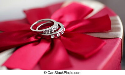 Wedding rings on bow - Wedding rings on a red bow