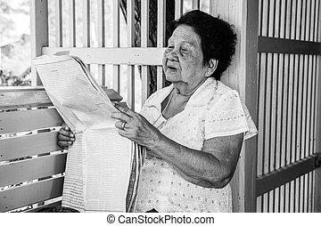 Senior asian woman Relaxing With Newspaper - Black and white...