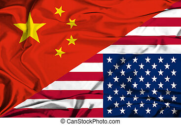 Waving flag of United States of America and China