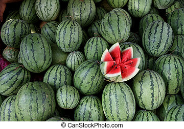 Water melon - Some water melon with one of them open