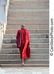 Buddist monk - A buddhist monk is going to the stairs
