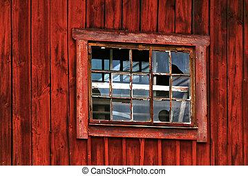 Broken window in red barn