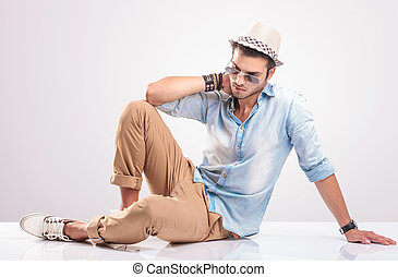 Full body picture of a young man lying on the floor - Full...