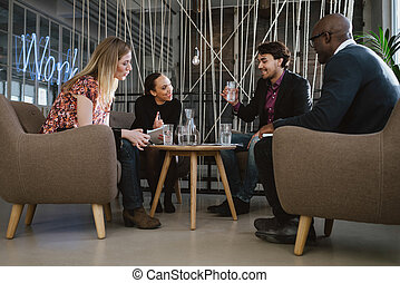 Happy multiracial business people in meeting - Multiracial...