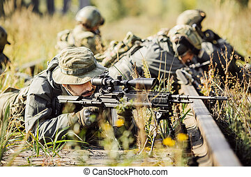 sniper shoot at a target from the sniper rifle - ranger...