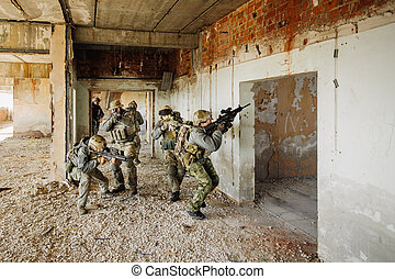 Soldiers stormed the building occupied by the enemy -...