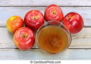 Apple cider vinegar with enzymes - Fresh apples and a bowl...