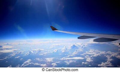 Looking through window aircraft during flight in wing with a...