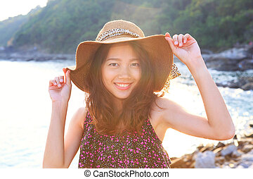 portrait face of beautiful woman wearing wide straw hat...