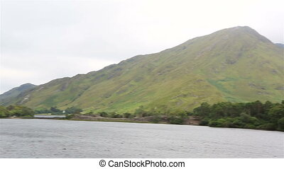 Beautiful lake near the Kylemore Abbey. National park...