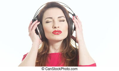 Pretty woman wearing red lipstick listening to the music...