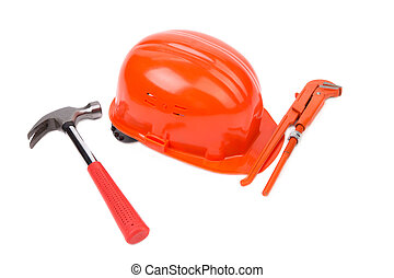 Red safety helmet with instruments Isolated on a white...