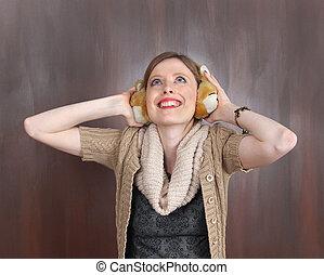 Earmuffs - Young girl wearing fluffy earmuffs with...